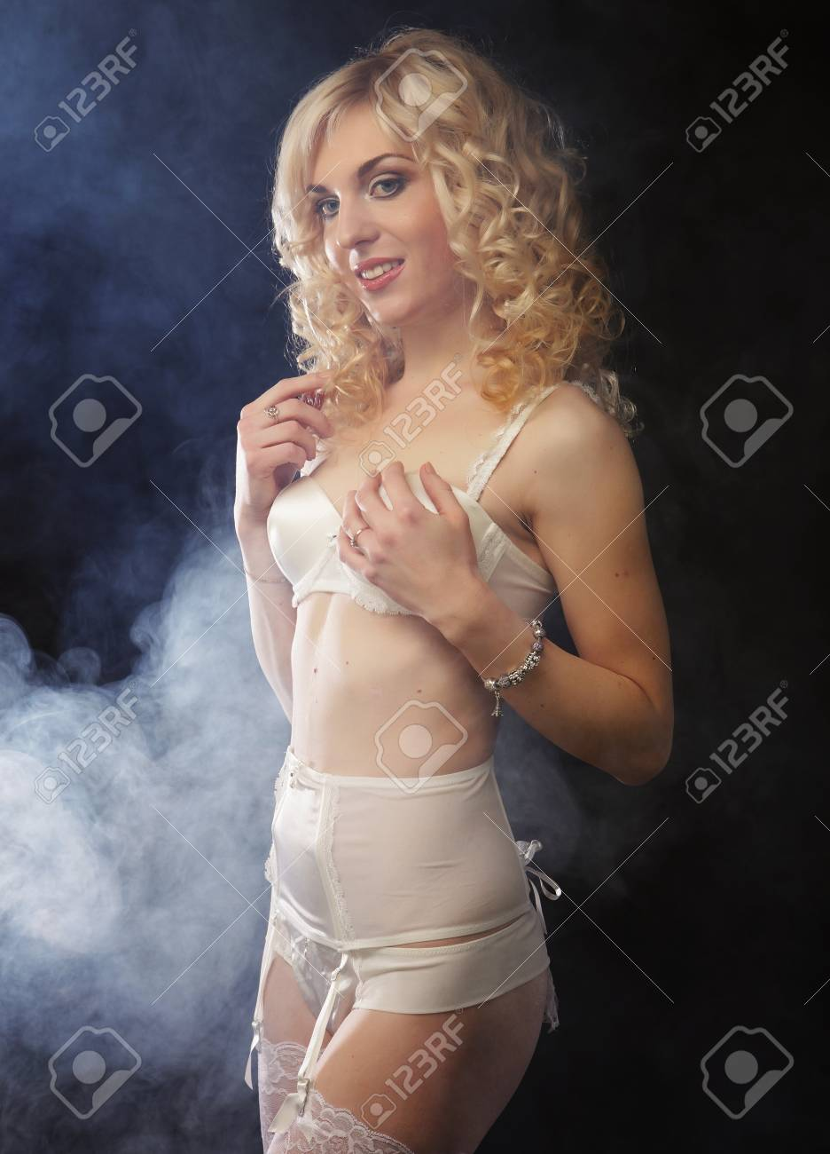 6969e1a0abf young sexy blond woman in lingerie over dark background Stock Photo -  42758432