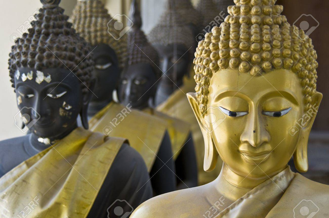 lots of statues of buddha sitting in lines Stock Photo - 8272233