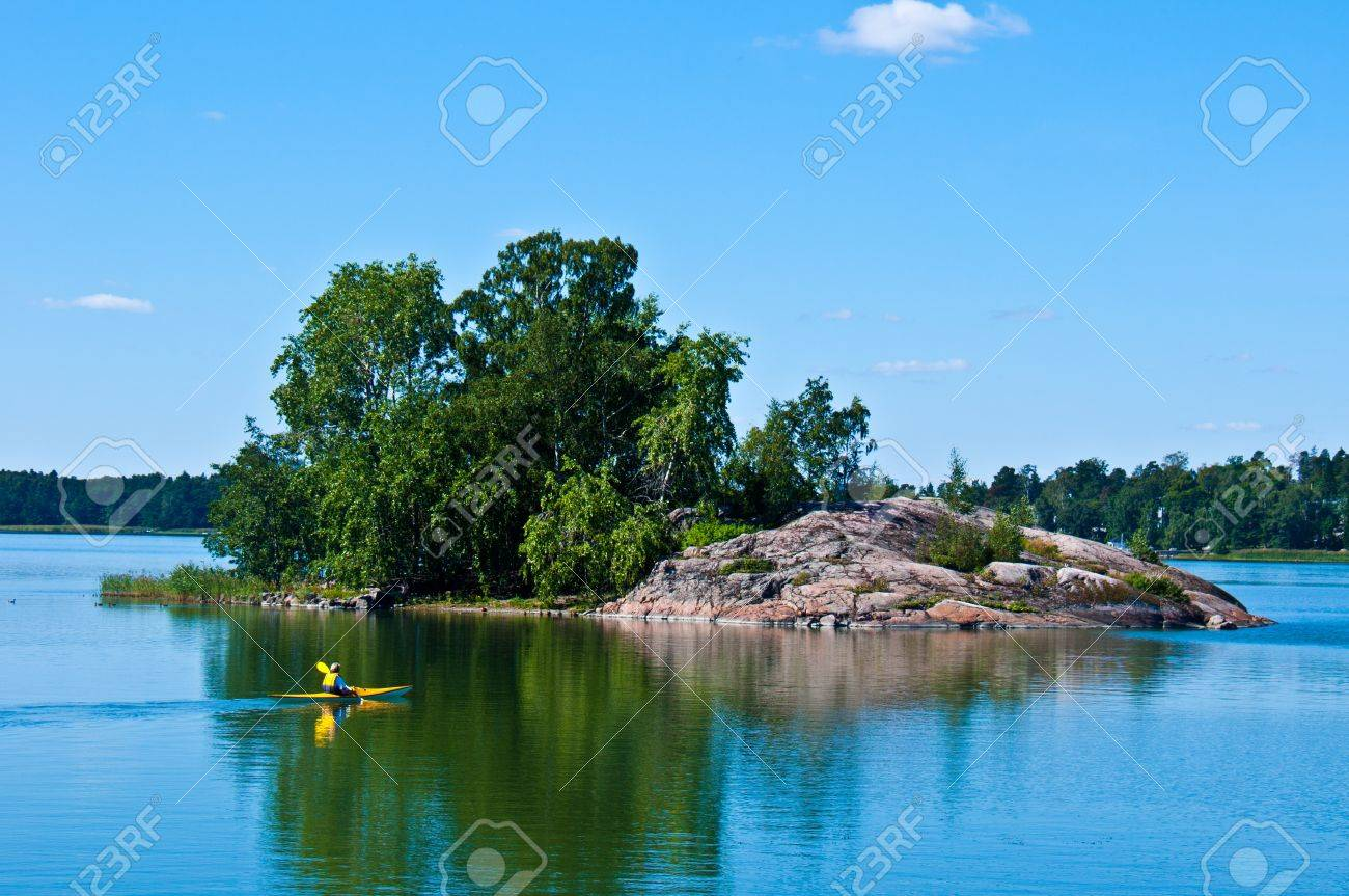 peaceful finnish scenery in Helsinki with a canoe in the distance Stock Photo - 10877115