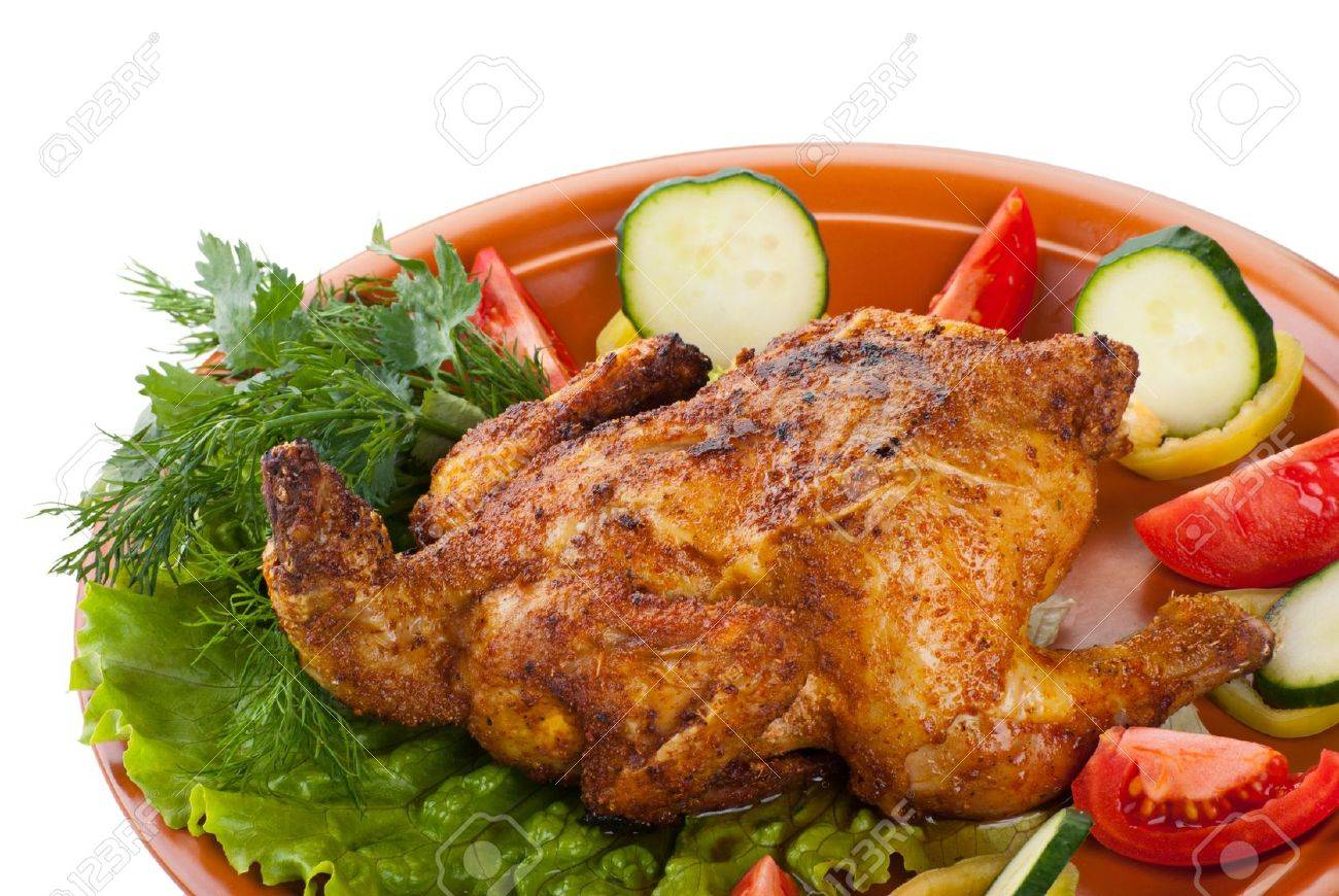 fresh grilled whole chicken with cucumber, raw tomatoes on plate with leaf lettuce isolated over white background Stock Photo - 11379926