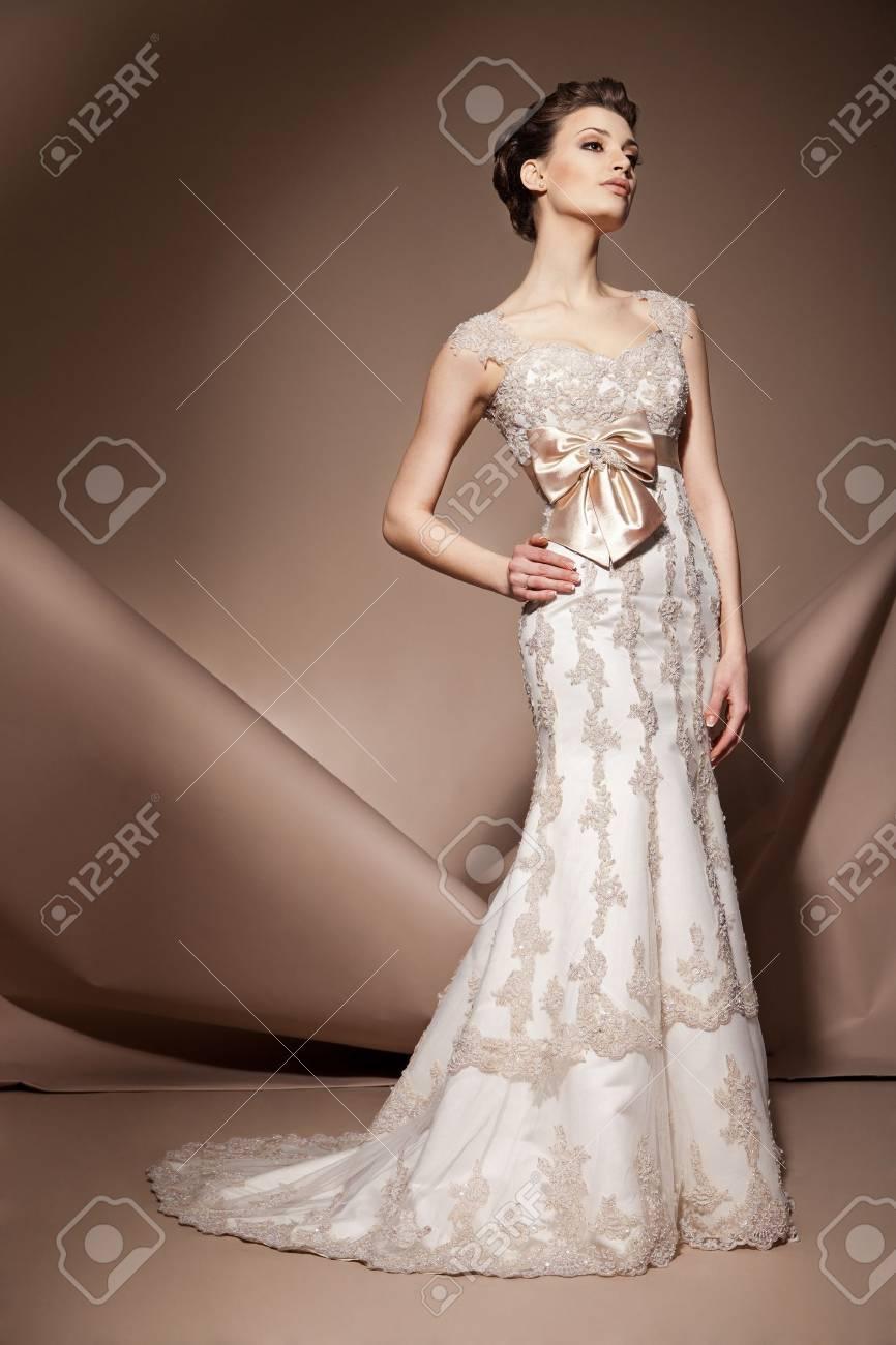 The beautiful young woman posing in a wedding dress - 17850543