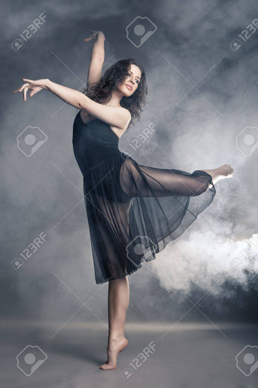 Modern style dancer posing on a studio grey background in fog Stock Photo - 19248516