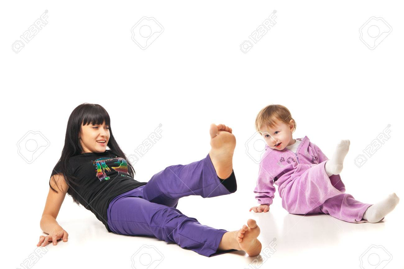 Yoga for woman and child. Mother with the baby doing exercises Stock Photo - 27002373