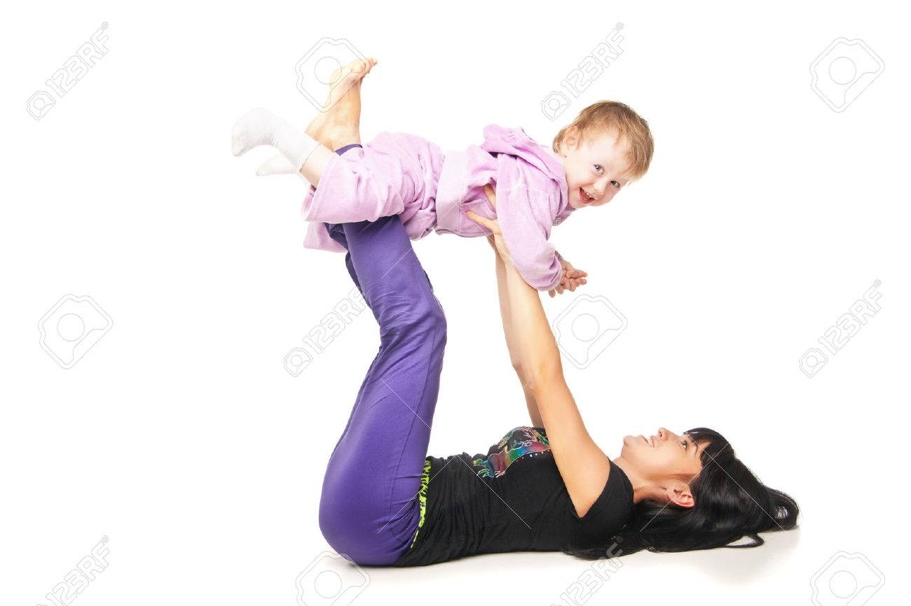 Yoga for woman and child. Mother with the baby doing exercises Stock Photo - 27011769