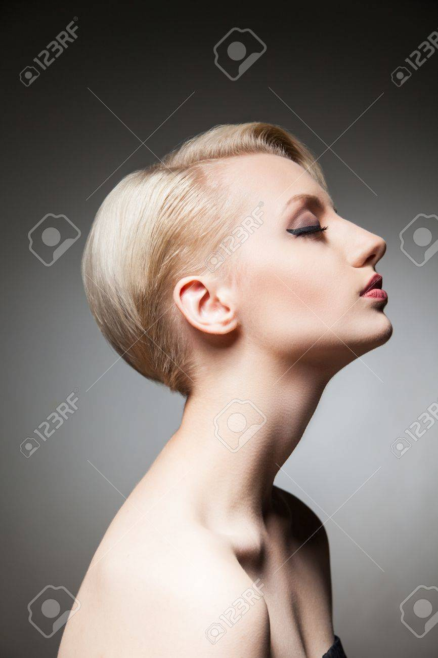 Side View Of Sensual And Dreaming Blonde Model With Hairstyle