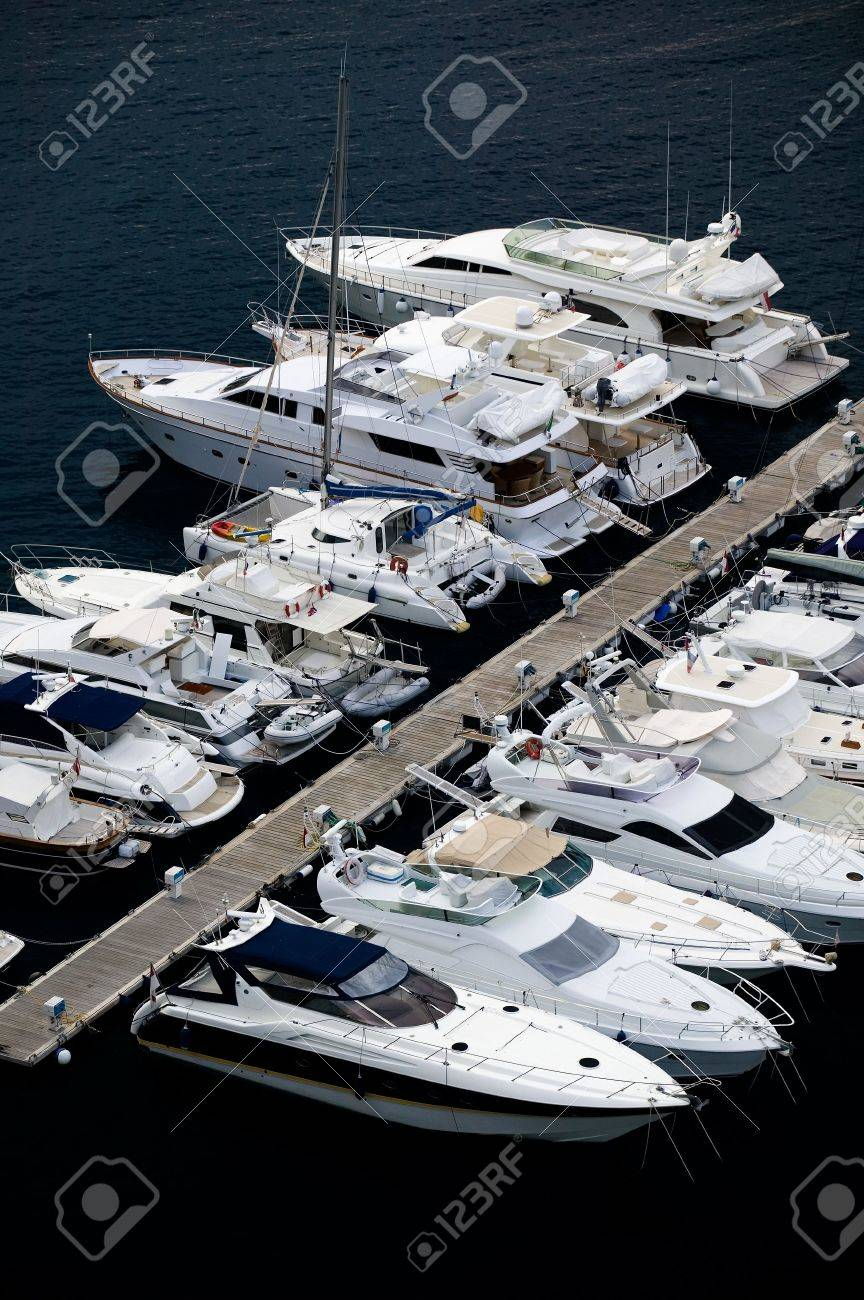 Luxury yachts at a wooden pier in Monte Carlo, Monaco. Stock Photo - 2875032