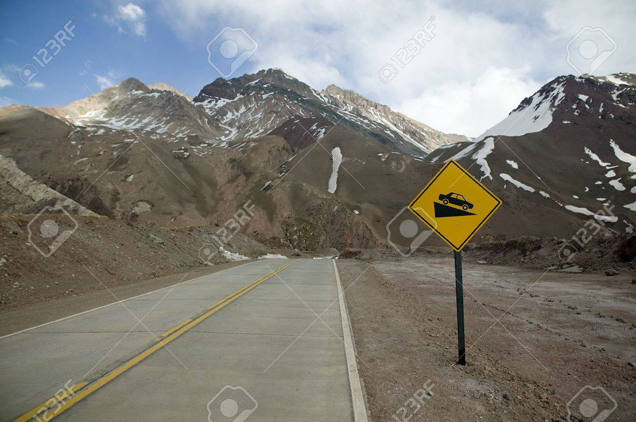 Yellow road sign on a mountain road in the Andes. Stock Photo - 2874935