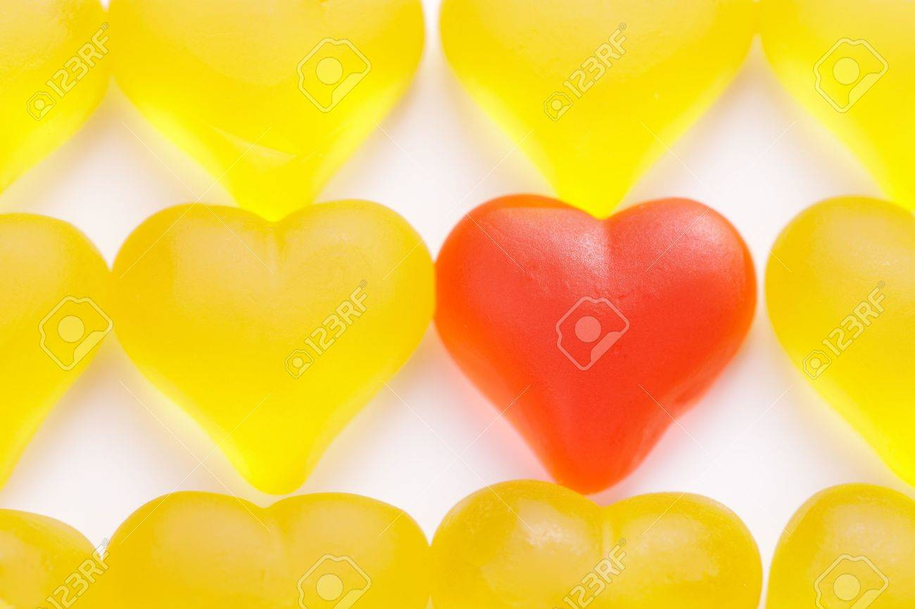 Red heart in a group of yellow hearts over white background. Stock Photo - 5681542