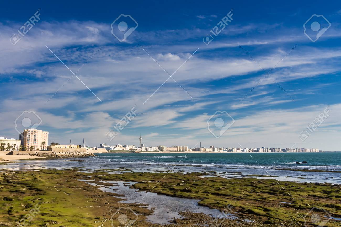 Moss Covered Rocks Off The Shores Of Bay Of Cadiz Stock Photo