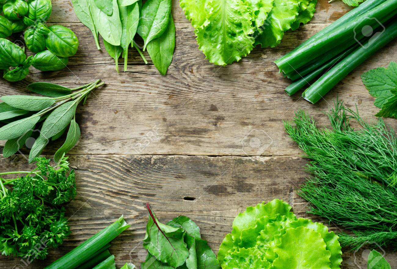 Frame of various fresh herbs on old wooden background. - 150352162
