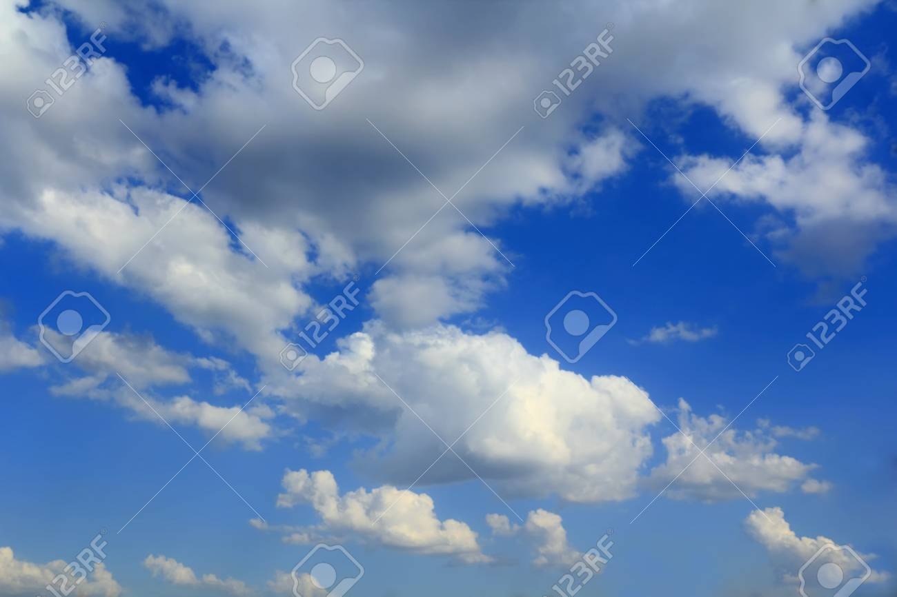 Image of the summer fluffy blue sky Stock Photo - 16991975