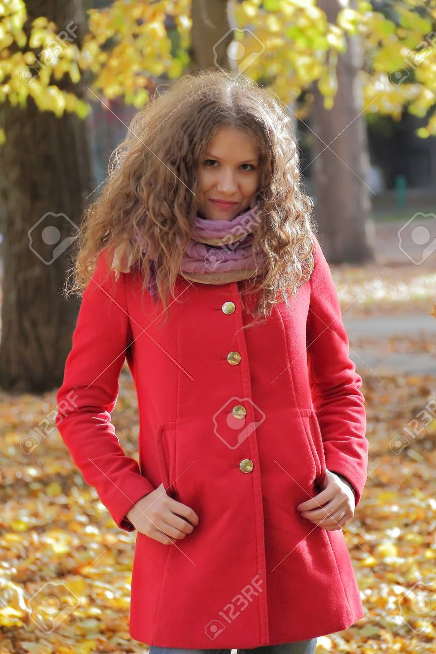 Image of beautiful young woman with autumn leaves Stock Photo - 17456131