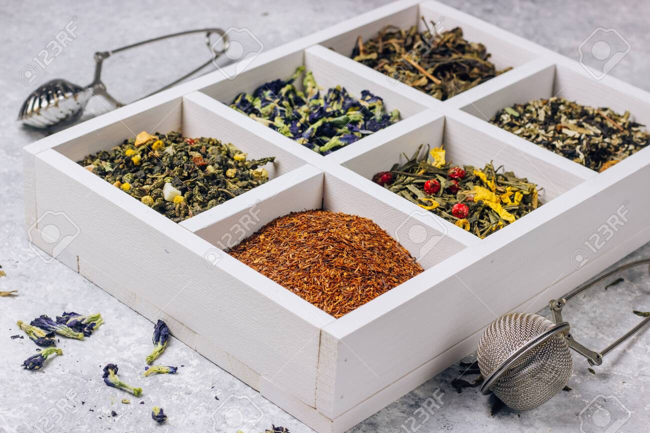 Assortment Of Dry Tea In White Wooden Box Tea Types Backgound