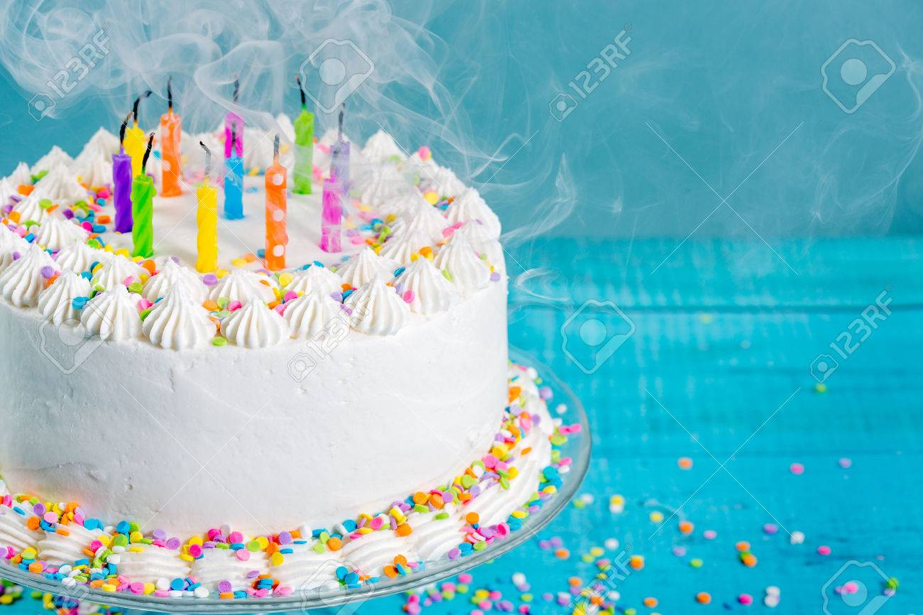 White Buttercream Icing Birthday Cake With Blown Out Candles Stock