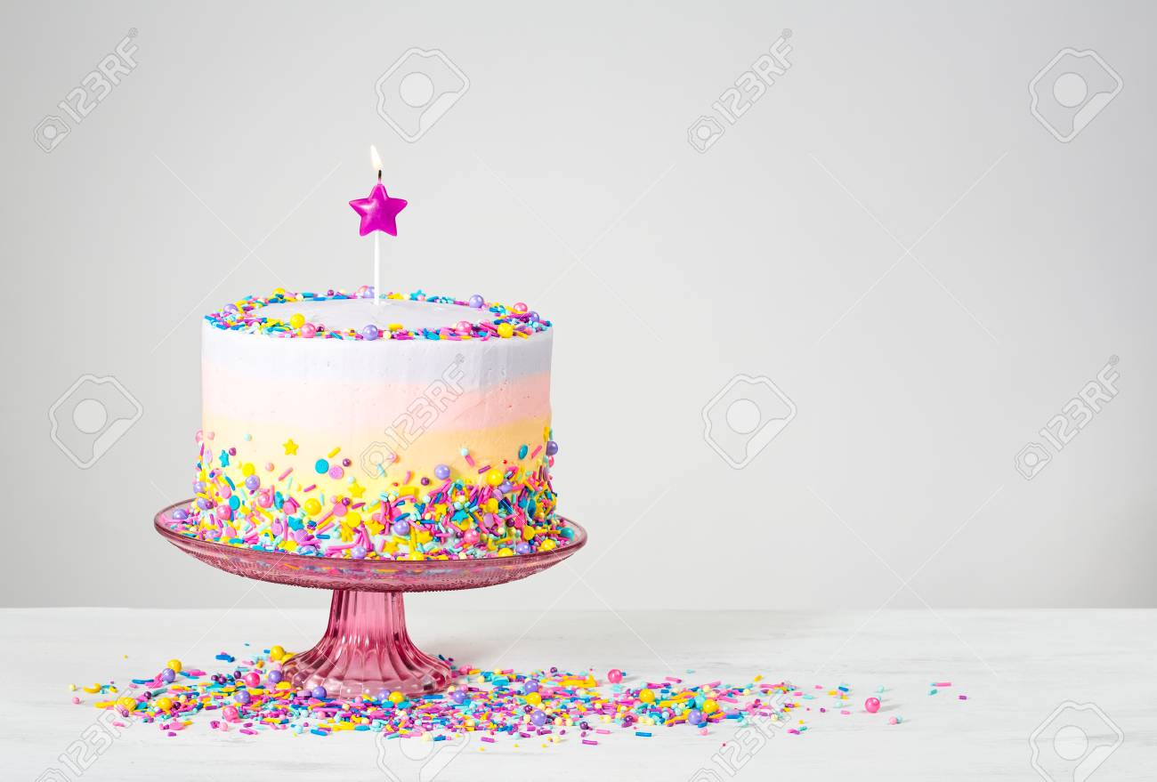 Birthday Cake With Star Candle And Colorful Sprinkles Stock Photo