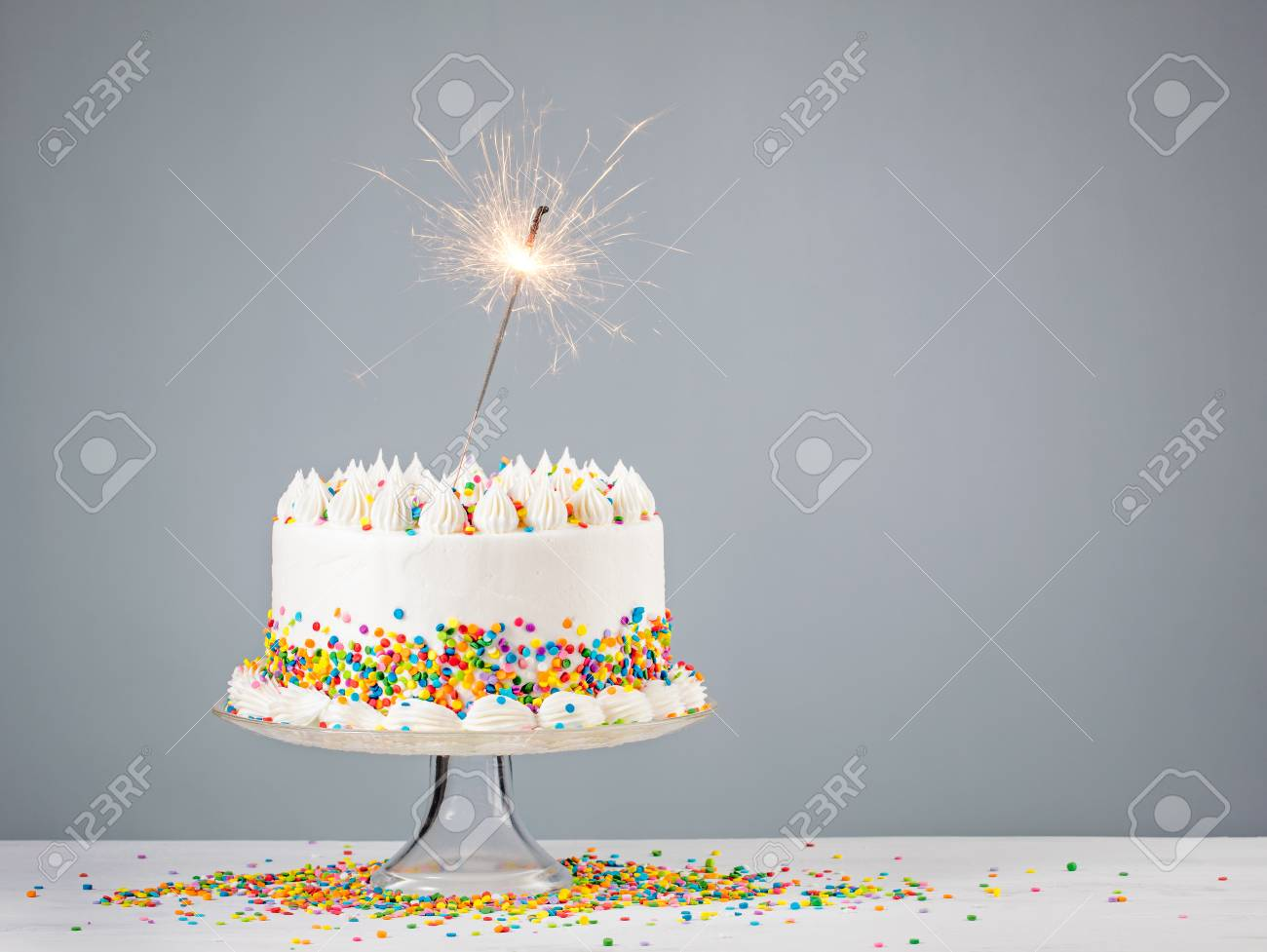 Surprising White Birthday Cake With Colorful Sprinkles And Sparkler Over Funny Birthday Cards Online Alyptdamsfinfo
