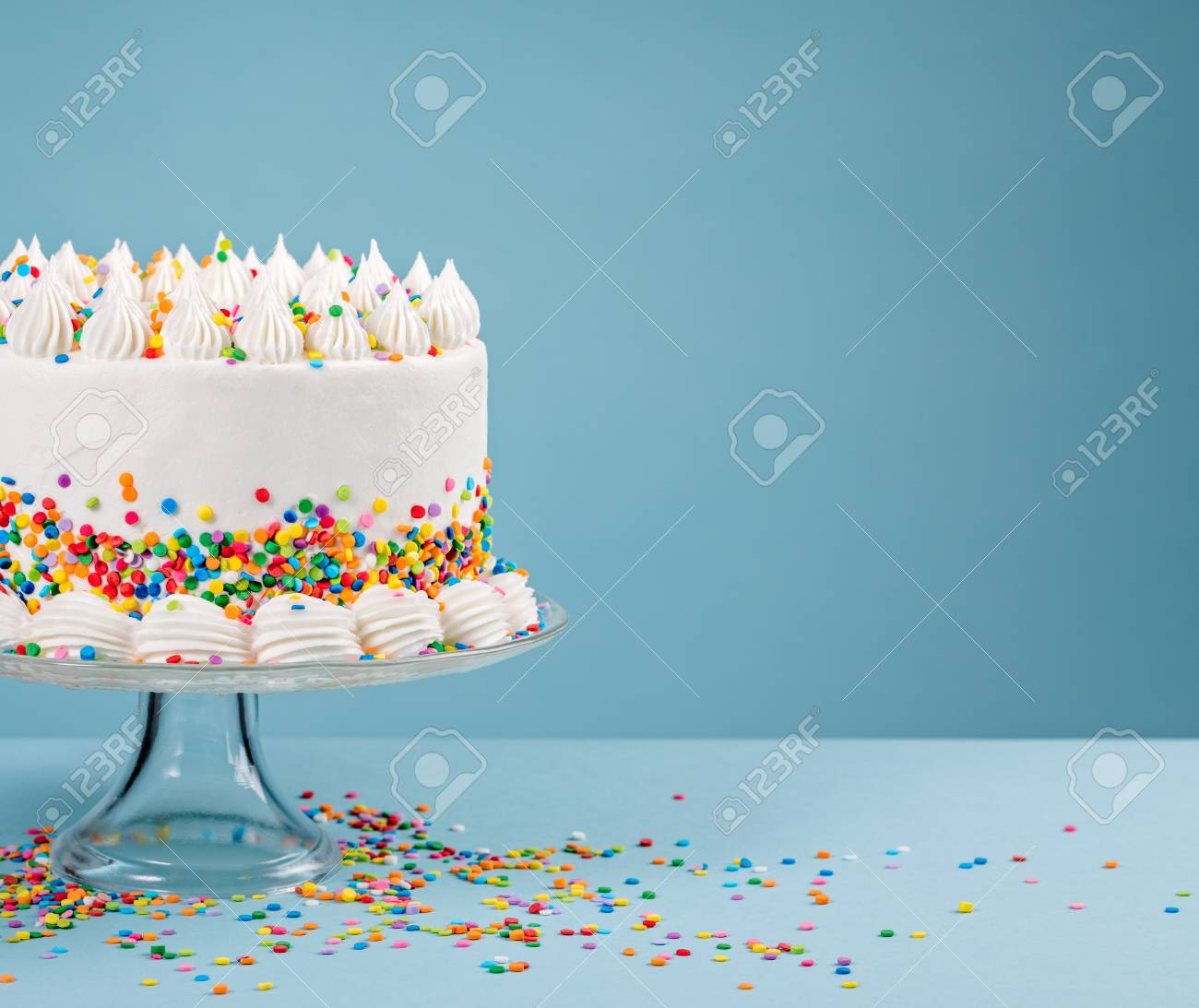 Tremendous White Birthday Cake With Colorful Sprinkles Over A Blue Background Funny Birthday Cards Online Aeocydamsfinfo