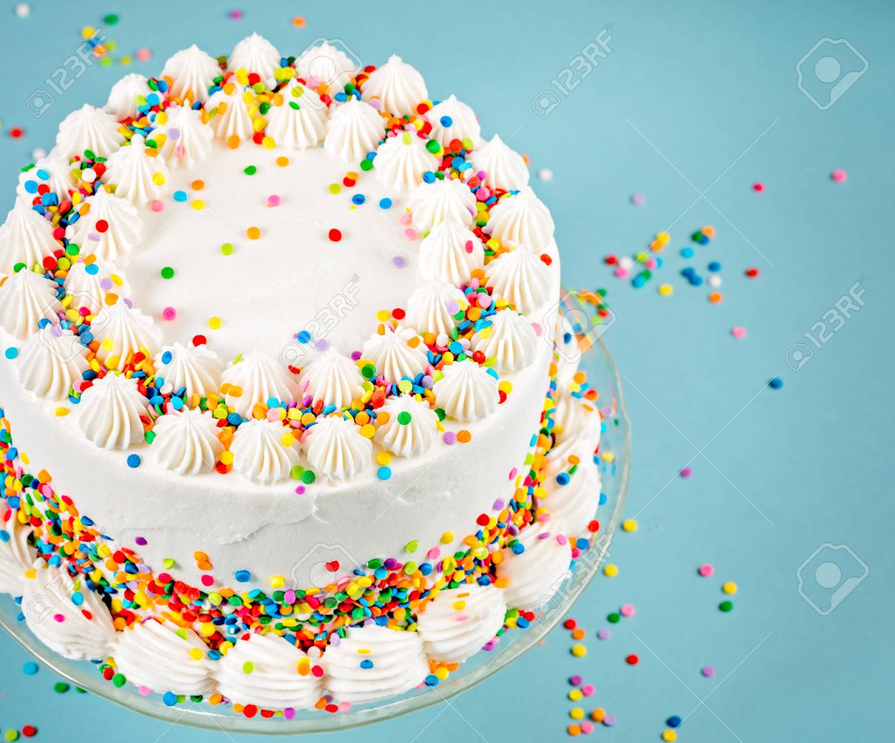 Incredible White Birthday Cake With Colorful Sprinkles Over A Blue Background Funny Birthday Cards Online Aeocydamsfinfo
