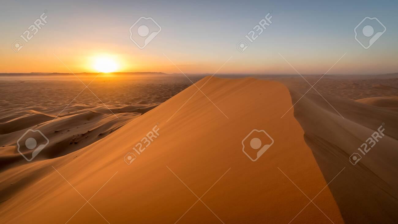 Orange skies during sunset at the sahara desert, Erg Chebbi, Merzouga, Morocco - 139123436