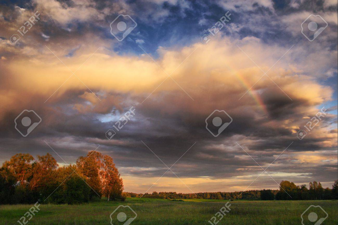 Evening landscape with rainbow Stock Photo - 5008082