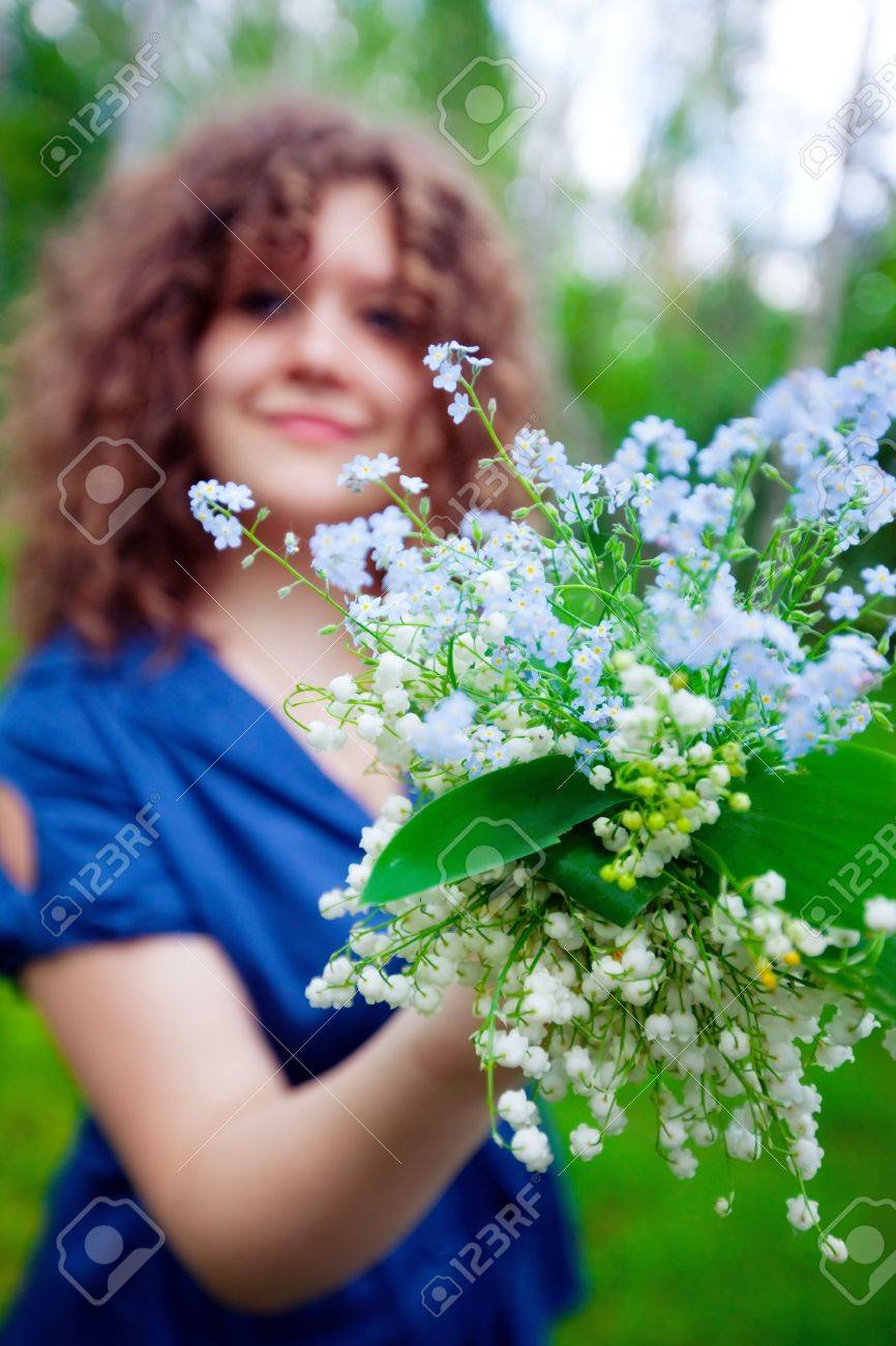Beautiful girl with bouquet of lilly of valley and  Forget me not Stock Photo - 7058389