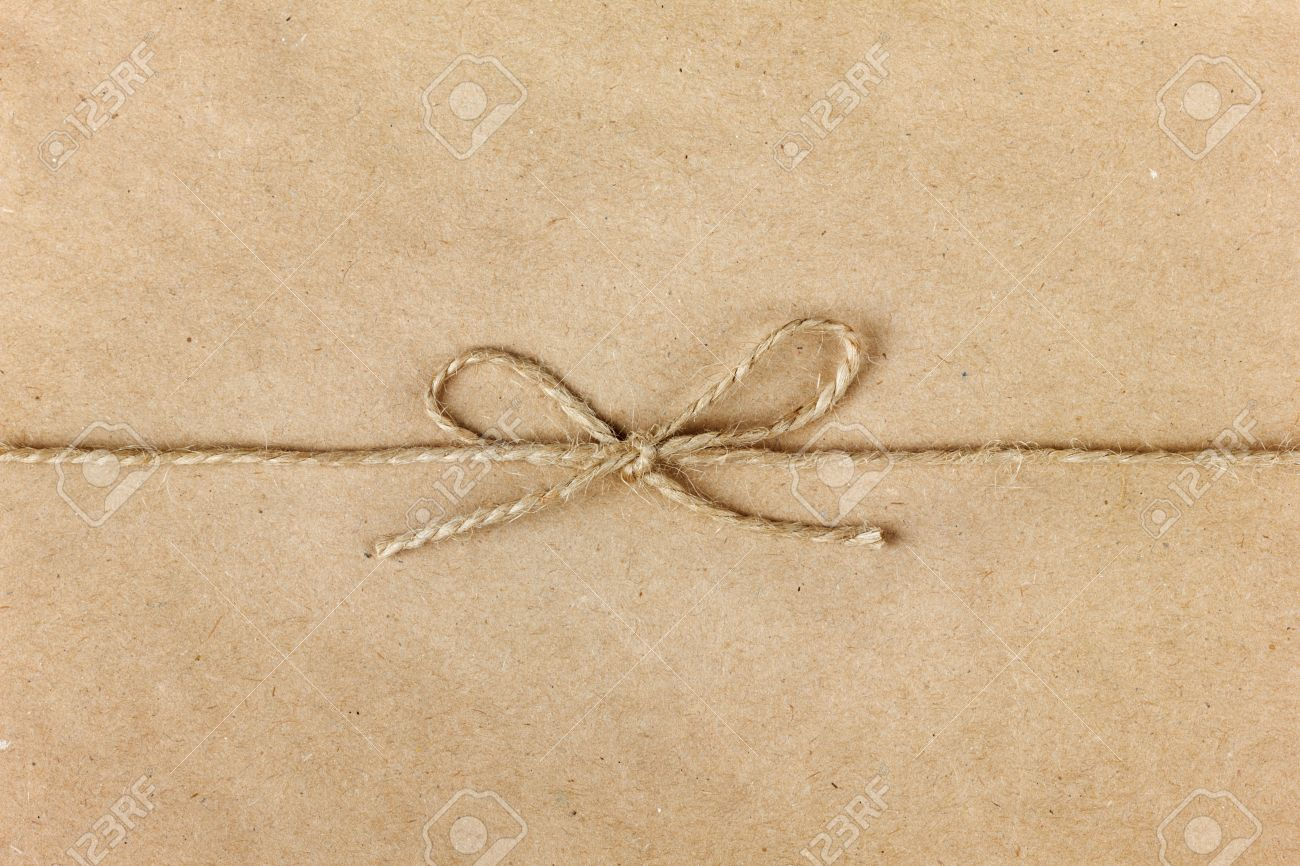 String Or Twine Tied In A Bow On Kraft Paper Background Stock ...