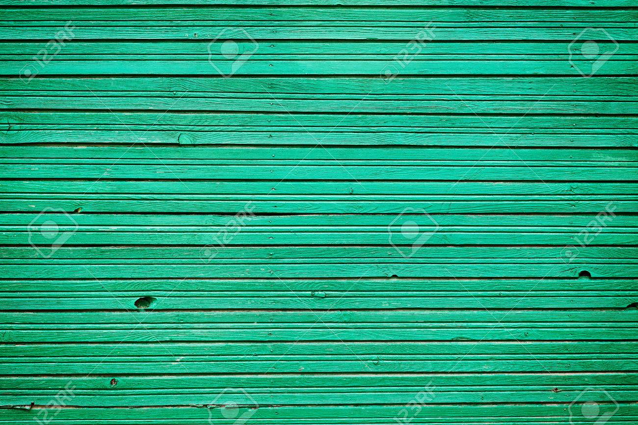 old vintage wooden planks with emerald color paint wall wood