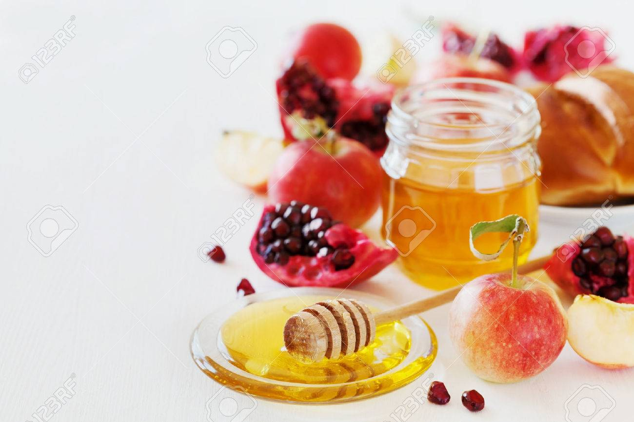 Rosh hashanah stock photos royalty free business images honey apple pomegranate and hala table set with traditional food for jewish new kristyandbryce Images