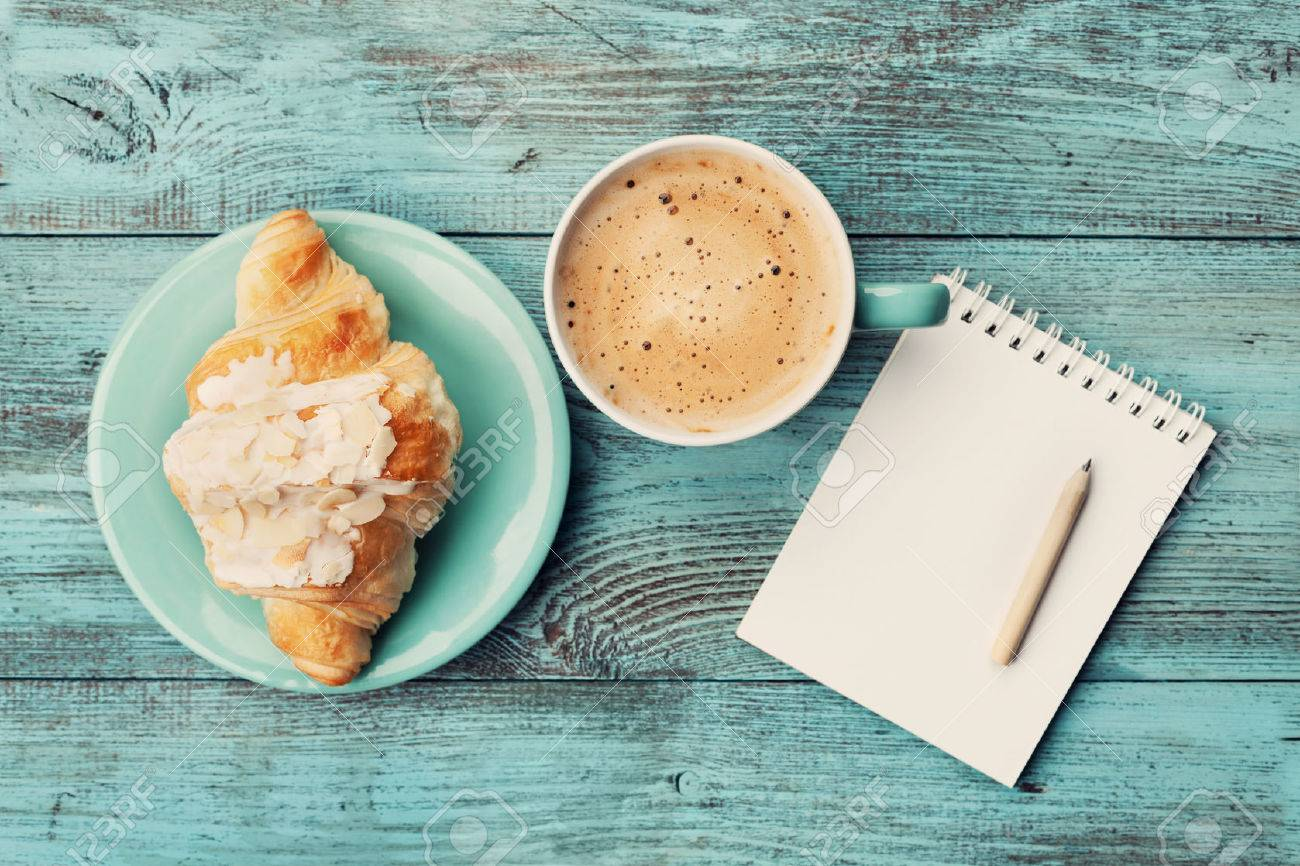 Coffee Mug With Croissant And Empty Notebook And Pencil For Business Stock Photo Picture And Royalty Free Image Image 53611043
