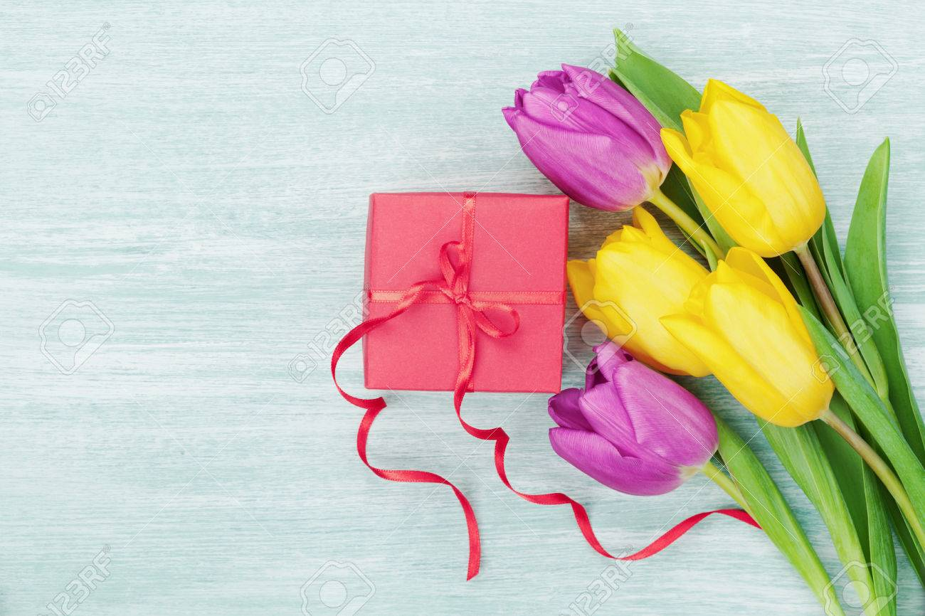Gift Box And Tulip Flowers On Rustic Table For March 8