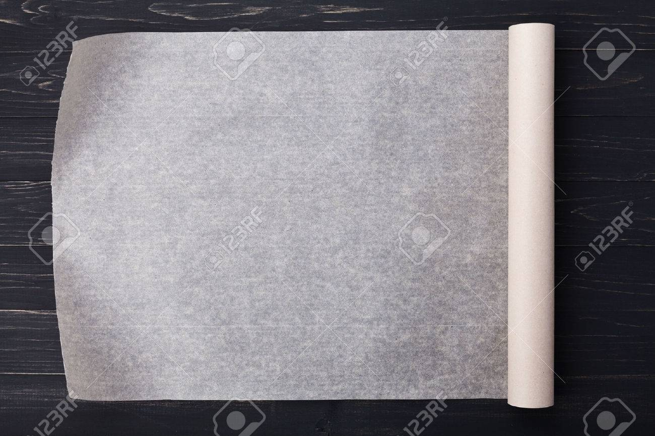 Baking paper on wooden kitchen table for menu or recipes top baking paper on wooden kitchen table for menu or recipes top view stock photo workwithnaturefo