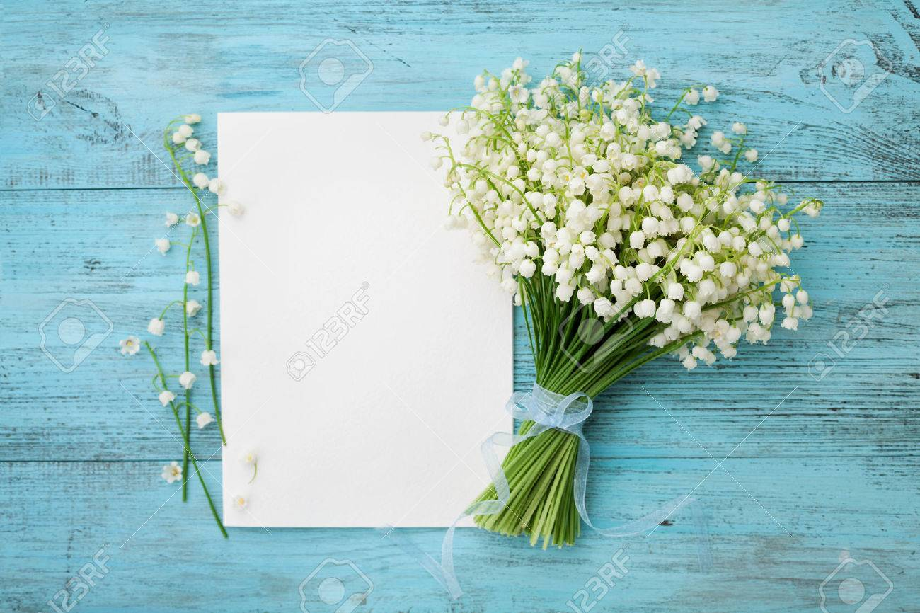Lily of the valley stock photos royalty free lily of the valley images bouquet of flowers lily of the valley and empty paper sheet on turquoise rustic table from izmirmasajfo Gallery