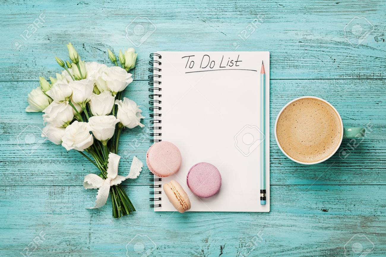Coffee mug with macaron white flowers and notebook with to do coffee mug with macaron white flowers and notebook with to do list on blue rustic mightylinksfo