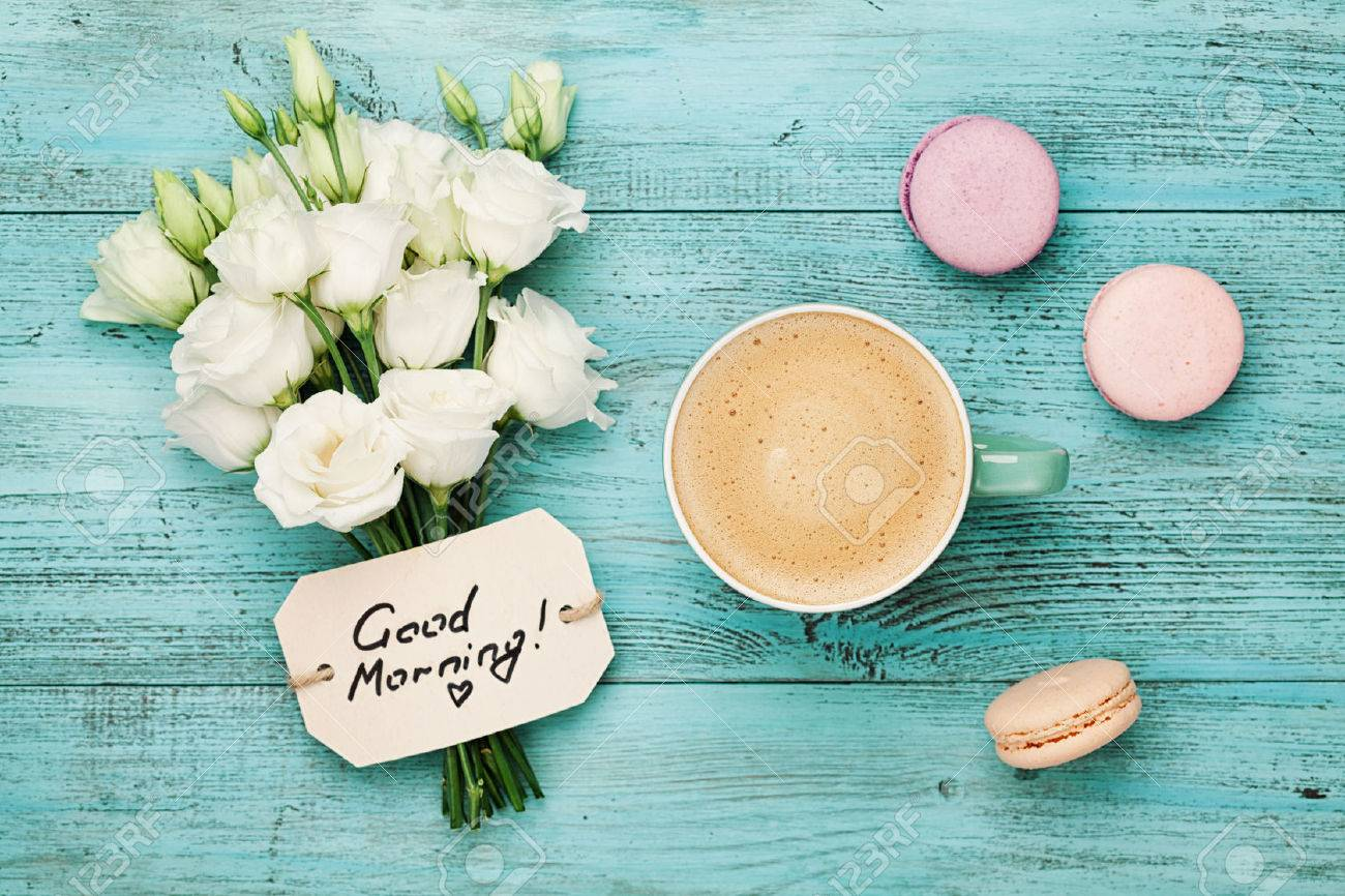 Coffee mug with macaron white flowers and notes good morning coffee mug with macaron white flowers and notes good morning on blue rustic table from mightylinksfo