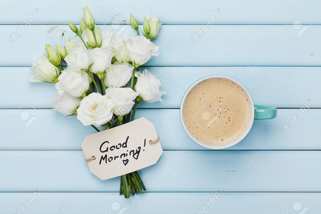 Coffee Mug With White Flowers And Notes Good Morning On Blue Stock