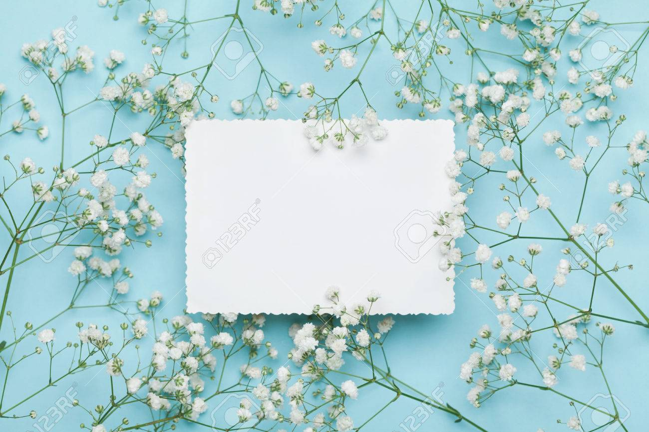 Wedding mockup with white paper list and flowers gypsophila on stock photo wedding mockup with white paper list and flowers gypsophila on blue table from above beautiful floral pattern flat lay style mightylinksfo