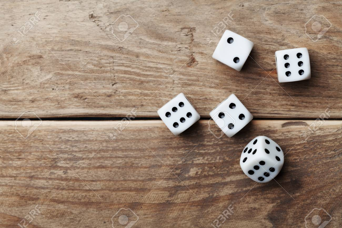 White Dice On Wooden Table Top View Gambling Devices Game Of Stock Photo Picture And Royalty Free Image Image 68962298