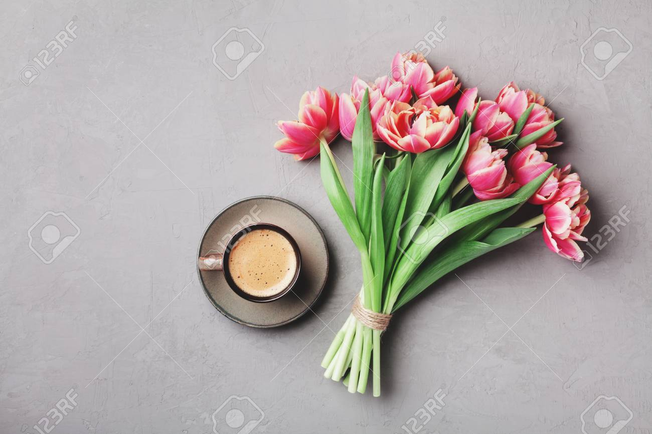Cup Of Coffee With Beautiful Pink Flowers For Good Morning On