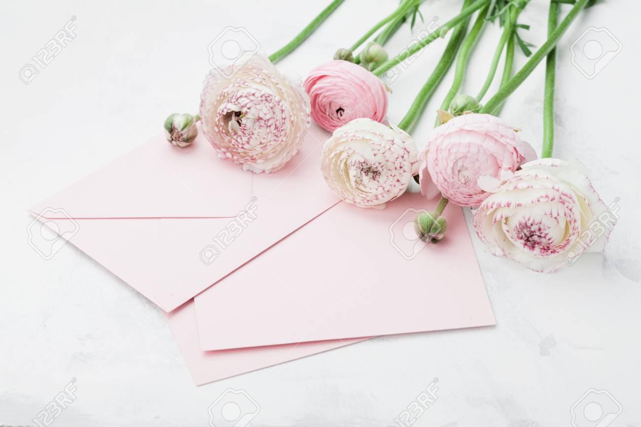 Envelope Or Letter Paper Card And Pink Ranunculus Flowers On