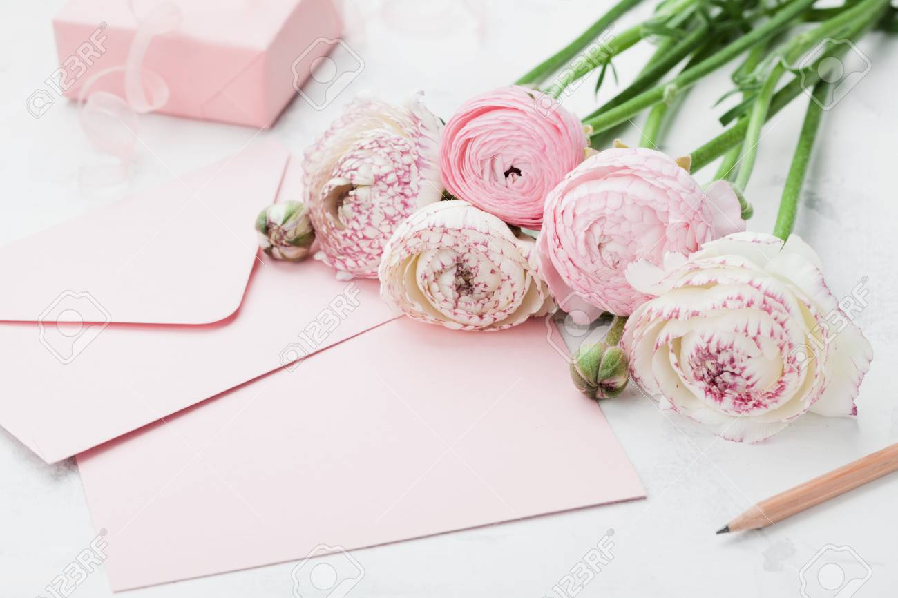 Envelope Or Letter Paper Card Gift And Pink Ranunculus Flowers