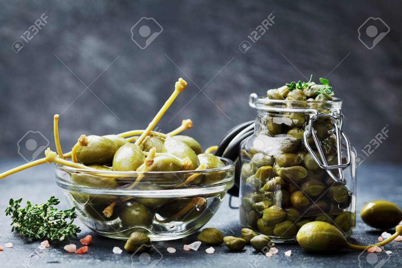 Mixed Capers In Jar And Bowl On Dark Kitchen Table. Stock Photo ...