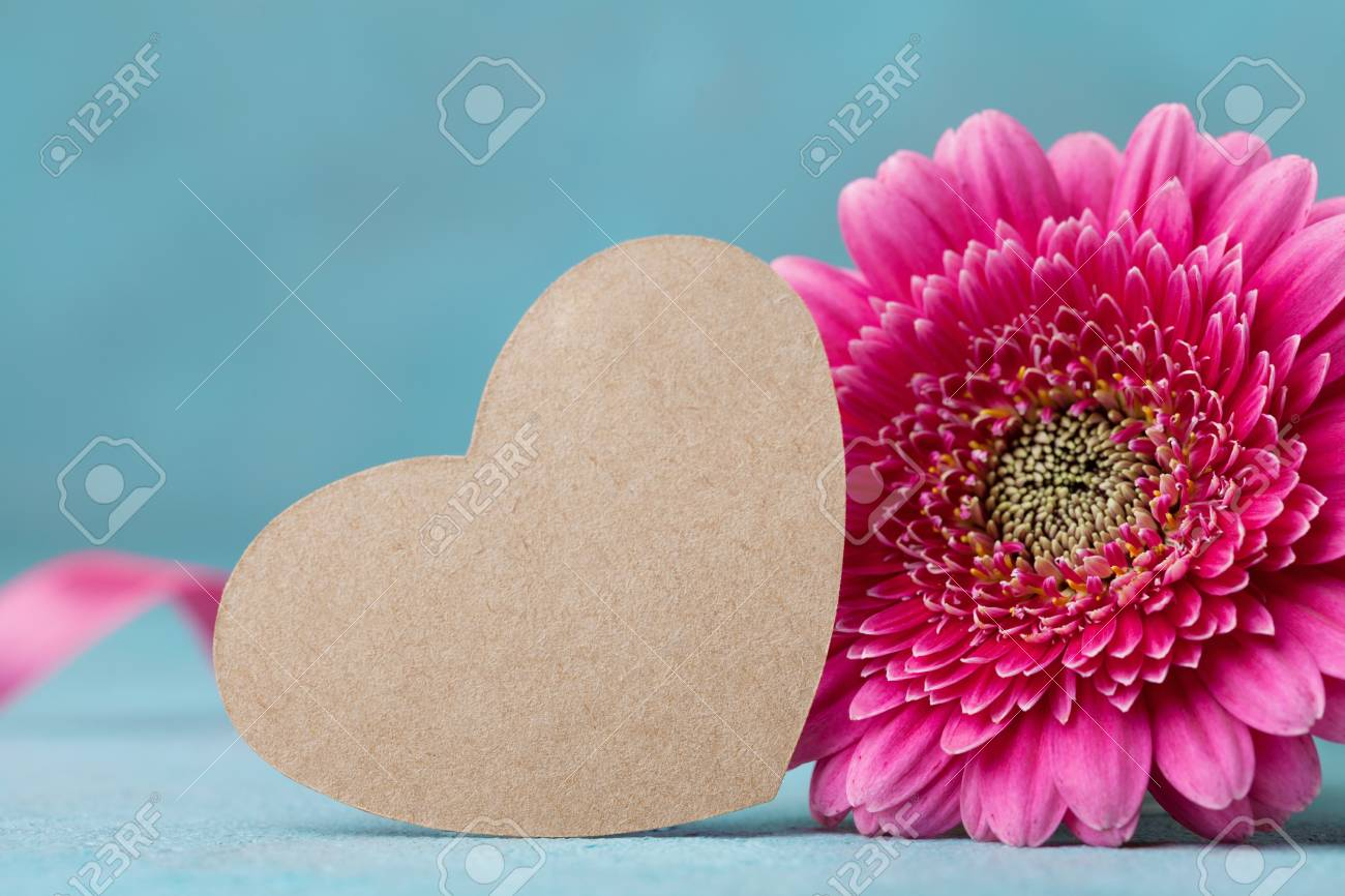 Paper Heart Tag And Beautiful Pink Gerbera Flower On Turquoise