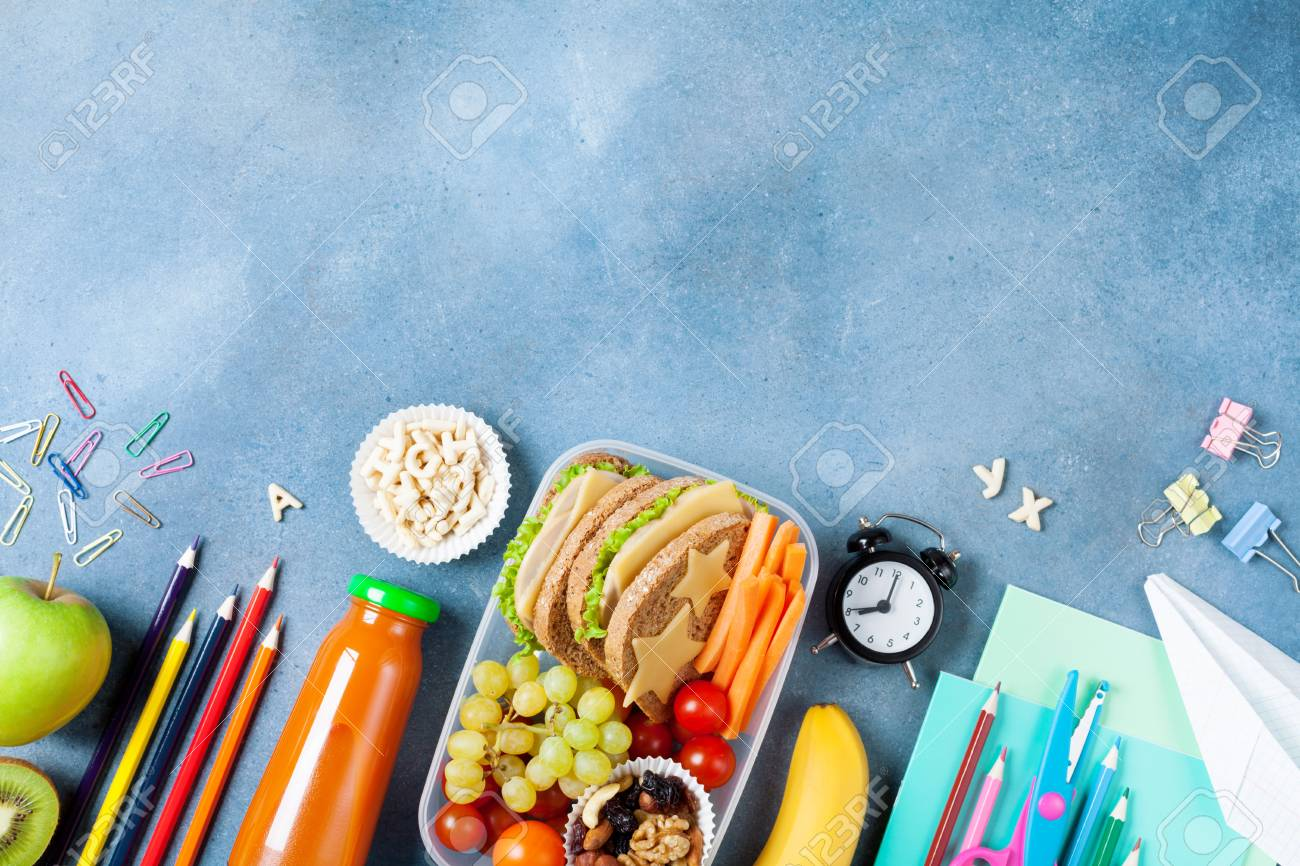 Back to school concept. Healthy lunch box and colorful stationery on blue table top view. - 106738413