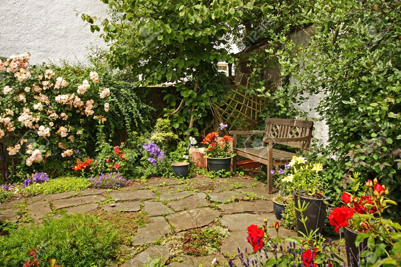Lovely Gardens lovely garden with a wooden bench stock photo, picture and royalty