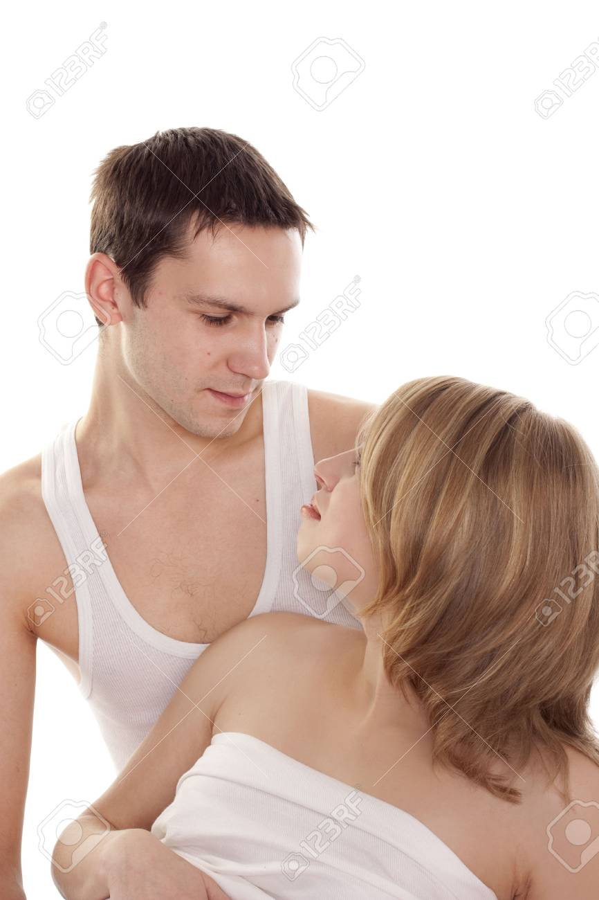 Young love couple smiling. Over white background Stock Photo - 6105742
