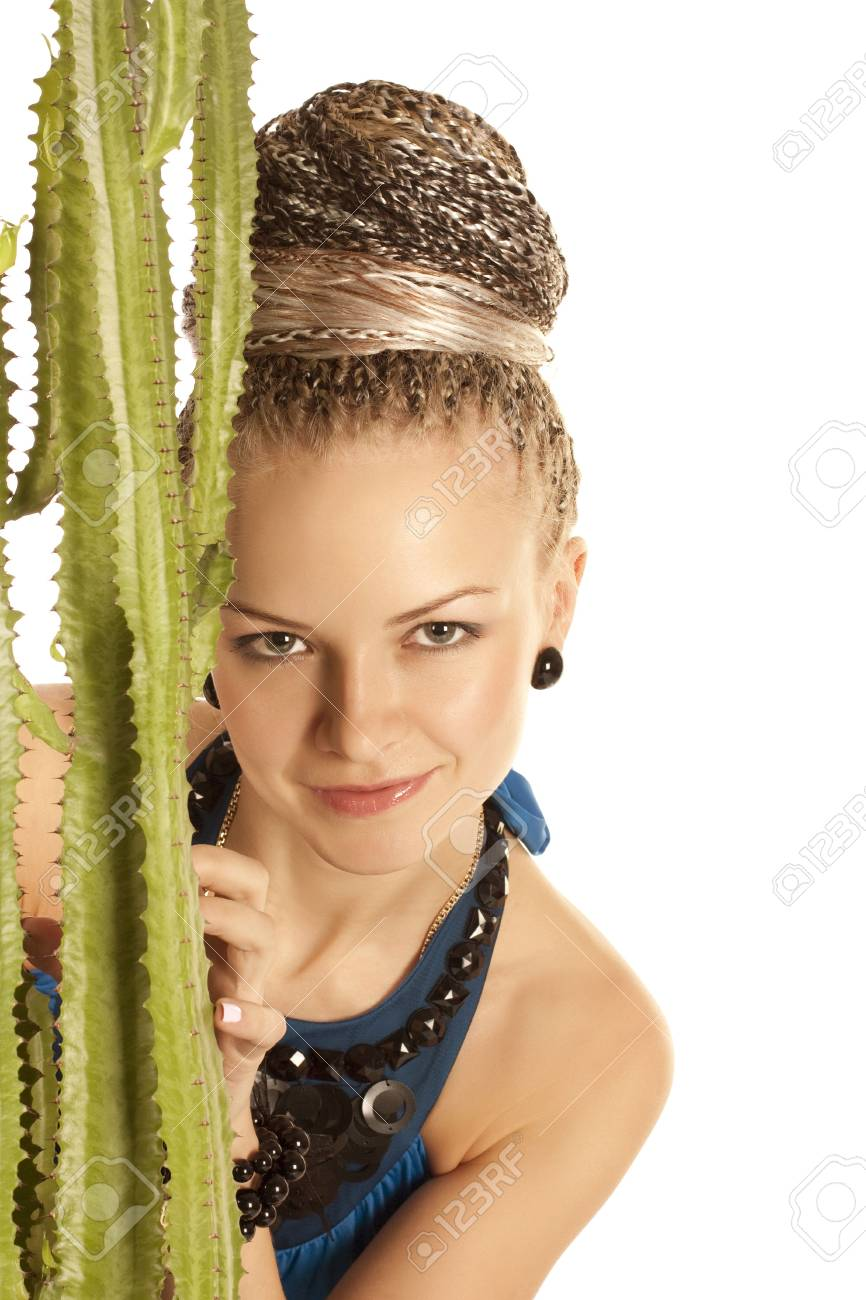 Portrait of the beautiful young woman with a green cactus on a white background Stock Photo - 6147104