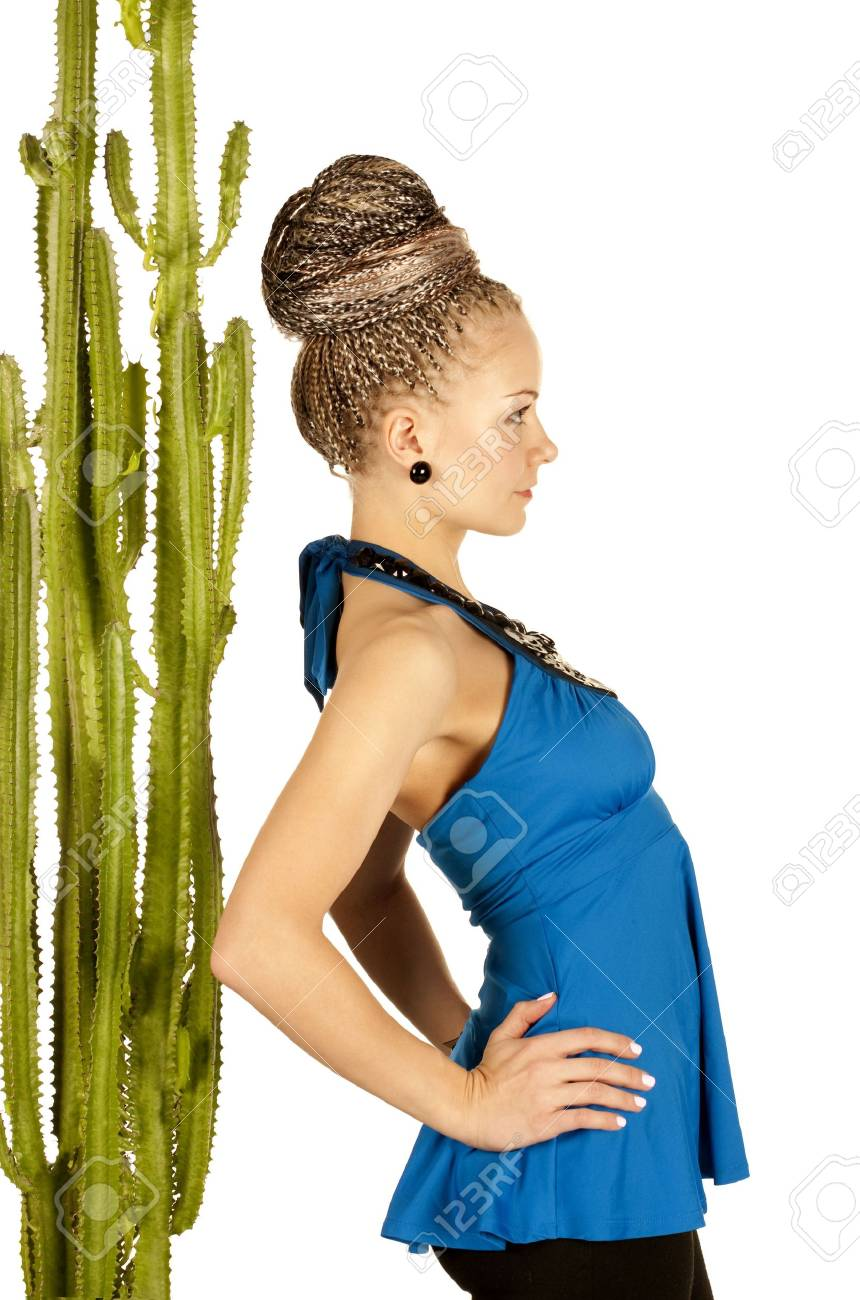 Portrait of the beautiful young woman with a green cactus on a white background Stock Photo - 6147061
