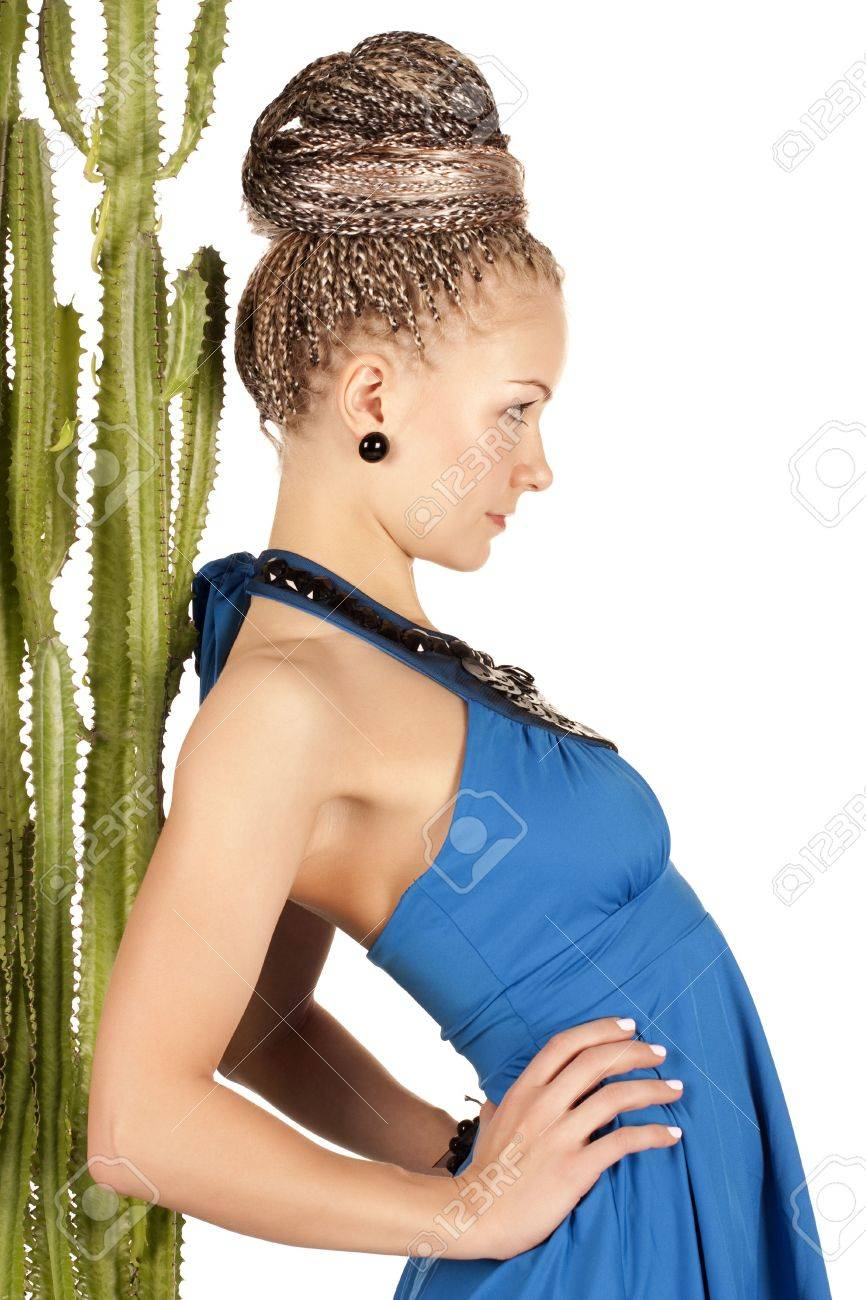 Portrait of the beautiful young woman with a green cactus on a white background Stock Photo - 6260860