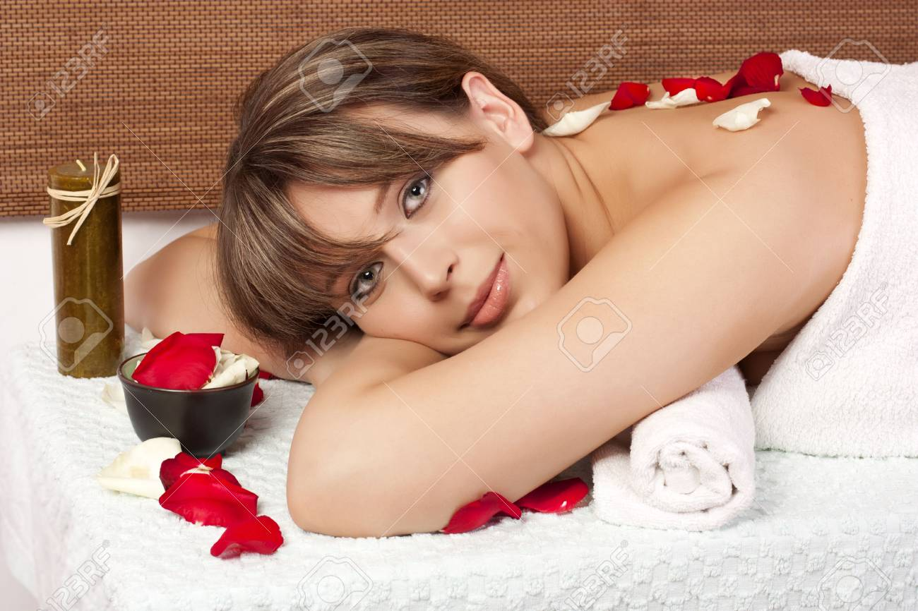 Beautiful woman on massage table with flower in hair Stock Photo - 6743453