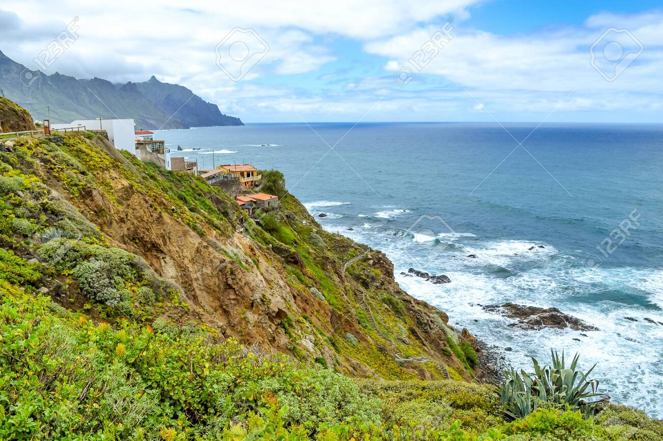 View of Benijo village, Canary island, Spain. The town in the north of Tenerife. Mountain green landscape and the ocean coast. - 143829298